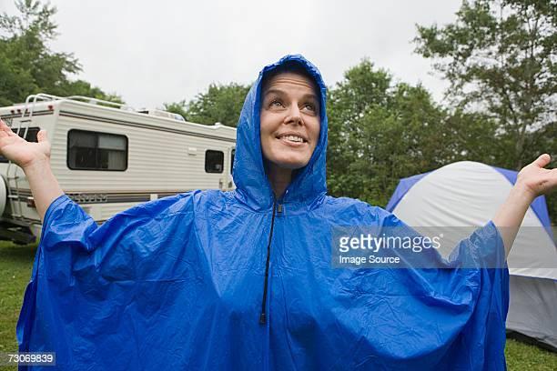 Woman wearing a blue plastic raincoat