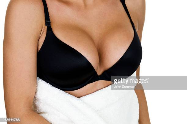 woman wearing a bra and bath towel - big cleavage stock photos and pictures