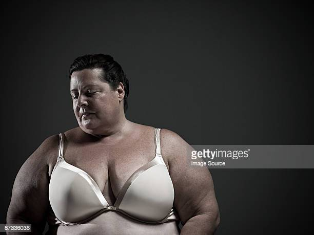 woman wearing a brassiere - big fat white women stockfoto's en -beelden