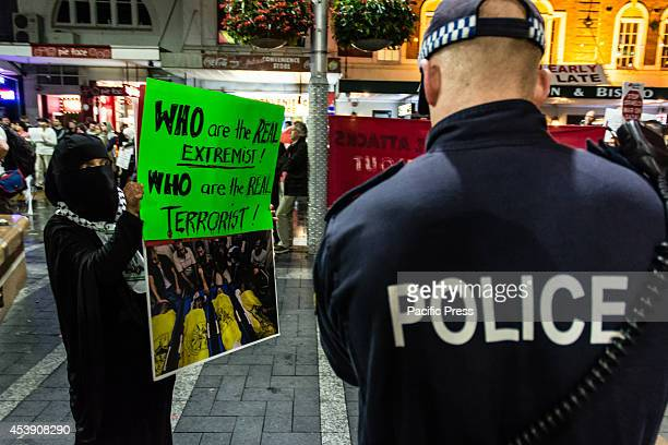 Woman wearing a burka parades in front of the NSW police holding a banners with dead Palestine children at a ProPalestine protest against the Israeli...