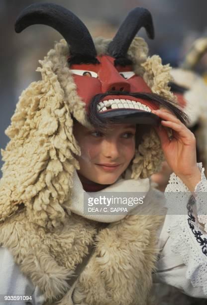 Woman wearing a buso mask Mohacs carnival Hungary