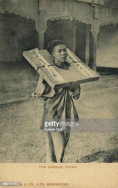 Woman wearing a cangue a device for public humiliation and corporal punishment A typical cangue would consist of a large heavy flat board with a hole...