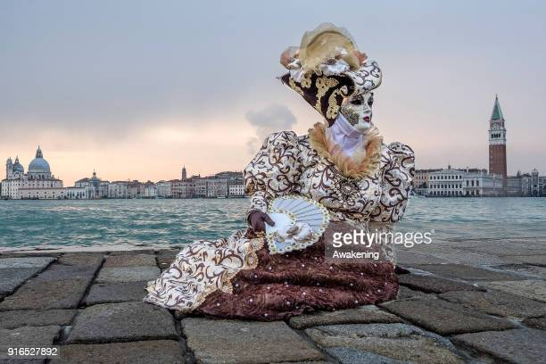 A woman wearing a carnival costume poses in San Giorgio island on February 10 2018 in Venice Italy The theme for the 2018 edition of Venice Carnival...