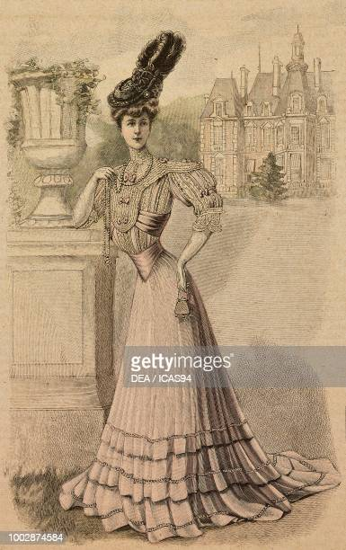 Woman wearing a Castle dress in fine linen, pleated skirt, lace corset and a hat with ruffles and ostrich feathers, creation by Madame Hoet, colored...