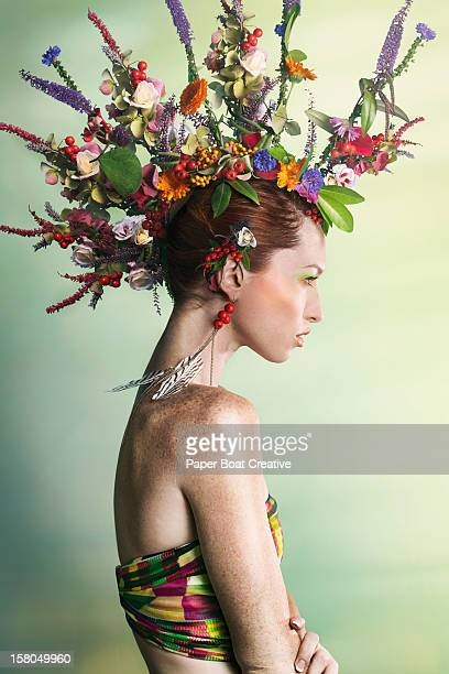woman wearing a colorful floral mohawk - multi colored hat stock pictures, royalty-free photos & images