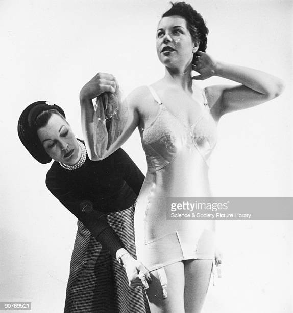 Woman wearing a combined bra and corset sometimes known as a �corselette�