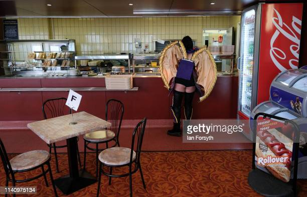 Woman wearing a cosplay outfit waits at the counter of a cafe on the second day of the Scarborough Sci-Fi weekend held at the seafront Spa Complex on...
