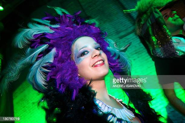A woman wearing a costume poses during a Halloween Eve Party in Belgrade on October 30 2011 Halloween is based on the Celtic festival of Samhain and...