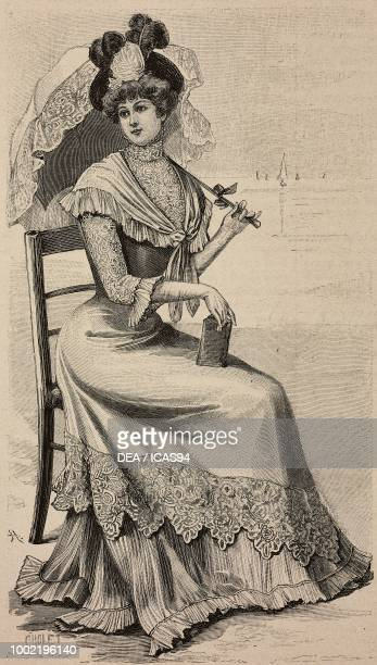 Woman wearing a crepe de chine dress with a shawl parasol umbrella Louise Piret design engraving from La Mode Illustree No 24 June 11 1899