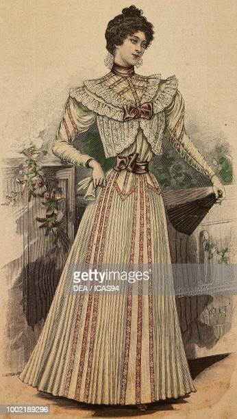 Woman wearing a crepe de chine dress with lace inserts and bows fan and gloves coloured engraving from La Mode Illustree No 33 August 15 1897