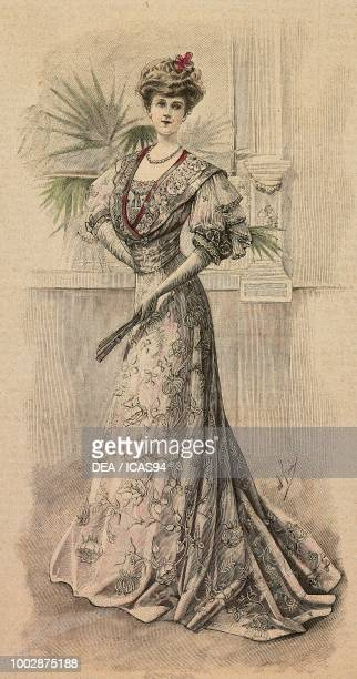 Woman wearing a Crepe de Chine meeting dress with floral embroidery muslin corset decorated with sequins and lace creation by Desbuissons and...