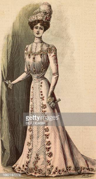 Woman wearing a crepe de Chine morning visiting or shopping dress creation by Mademoiselle Louise Piret engraving from La Mode Illustree No 18 May 6...