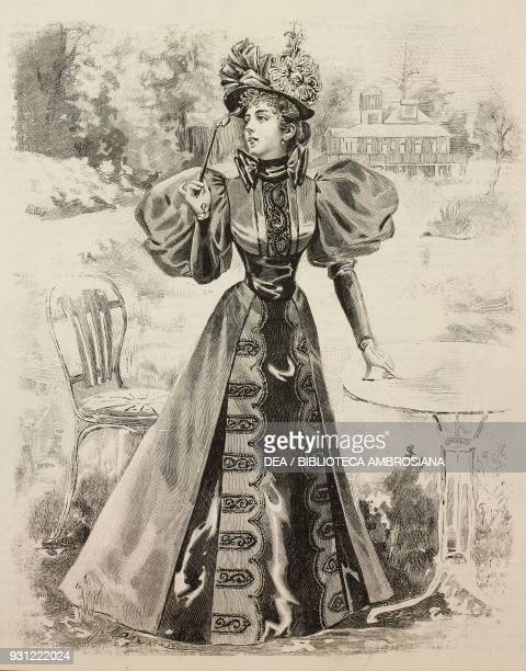 Woman wearing a dark spring dress with puffedsleeves hat with ribbons holding glasses in her hand drawing by Mademoiselle Magniart Revue de la Mode...