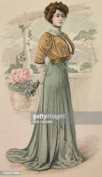 Woman wearing a dinner dress green Liberty silk skirt with train loose fitting Mordore tulle corset creation by Barrouin colored engraving from La...