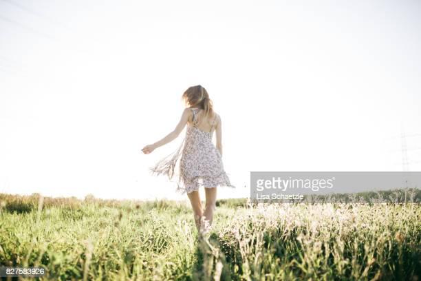 woman wearing a dress enjoys nature and freedom - サンドレス ストックフォトと画像