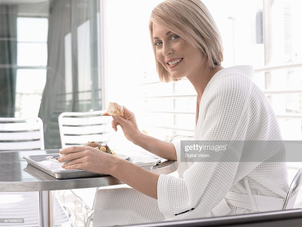Woman Wearing a Dressing Gown, Enjoying Breakfast in a Hotel : Stock Photo