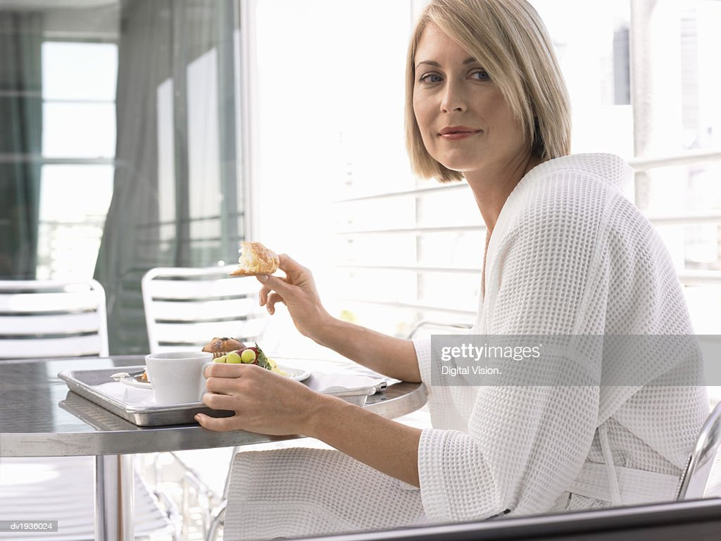 Woman Wearing a Dressing Gown, Having Breakfast in a Hotel : Stock Photo