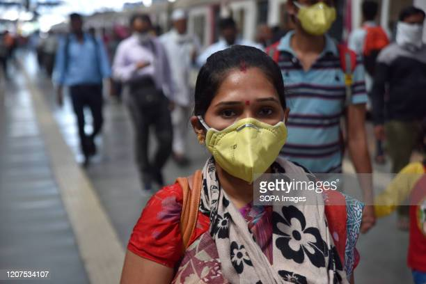 Woman wearing a face mask at Mumbai Cst railway station as a preventive measure during the corona virus pandemic COVID19 count cases are close to 130...