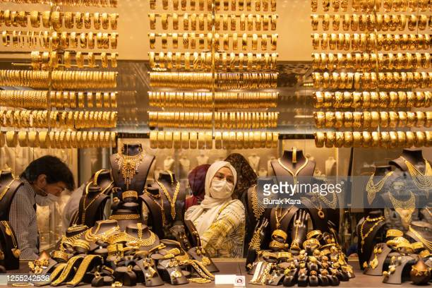 A woman wearing a face mask browses gold jewelry in a gold store in Istanbul's famous Grand Bazaar on July 09 2020 in Istanbul Turkey Turkey...