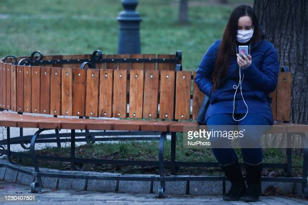 Woman wearing a face mask is seen in Krakow, Poland on January 2, 2021. Government introduced additional restrictions, until January 17, due to the...