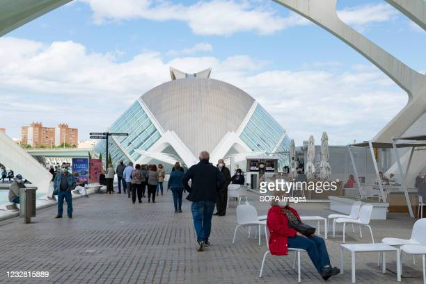 Woman wearing a face mask waits at the City of Arts and Sciences of Valencia. The good rate of vaccination in the Valencian Community allows people...