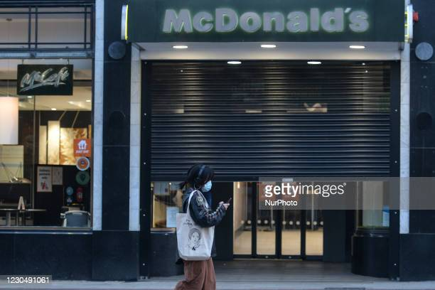 Woman wearing a face mask walks by McDonald's on Grafton Street, Dublin. The Department of Health reported today a new daily record of new cases for...