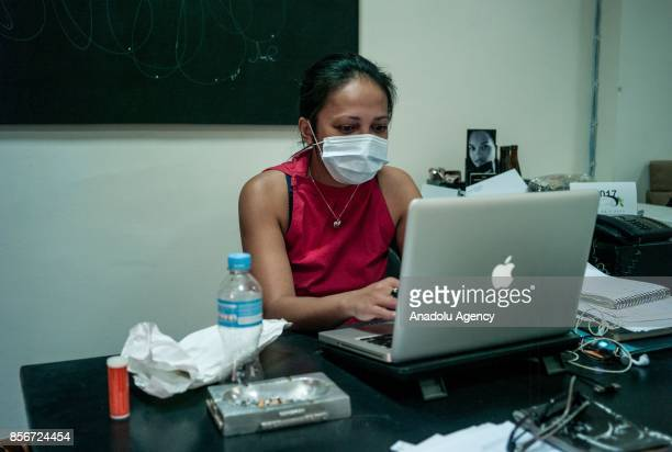 A woman wearing a face mask works in Antananrivo Madagascar as plague spreads rapidly in cities across the country on October 2 2017 Twenty people...
