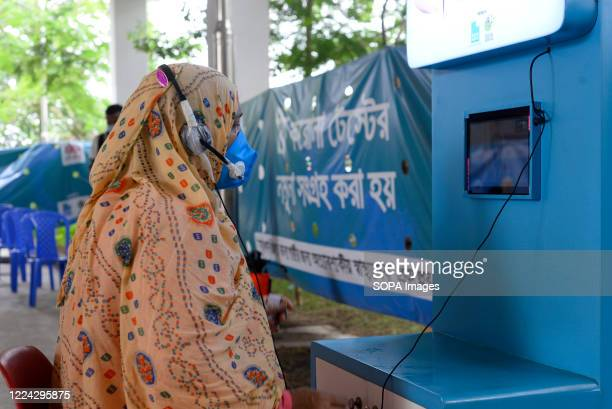 Woman wearing a facemask is seen talking with a doctor through a video chat during the Covid-19 testing. Mugda Medical College and Hospital employees...