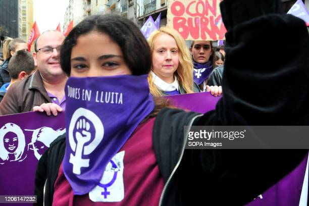 A woman wearing a feminist scarf during the International Women's Day demonstration demanding for gender equality with and against women violence in...