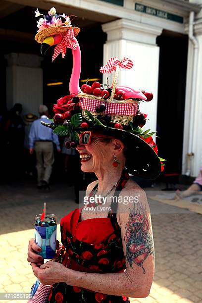 A woman wearing a festive hat looks on prior to the 141st running of the Kentucky Derby at Churchill Downs on May 2 2015 in Louisville Kentucky