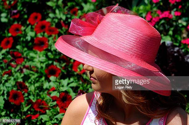 A woman wearing a festive hat looks on prior to the 142nd running of the Kentucky Oaks at Churchill Downs on May 06 2016 in Louisville Kentucky
