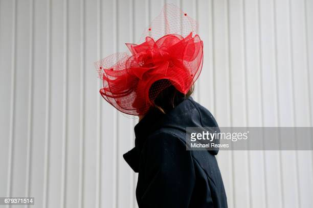 A woman wearing a festive hat looks on prior to the 143rd running of the Kentucky Oaks at Churchill Downs on May 5 2017 in Louisville Kentucky