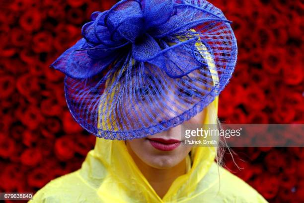 A woman wearing a festive hat poses prior to the 143rd running of the Kentucky Derby at Churchill Downs on May 6 2017 in Louisville Kentucky
