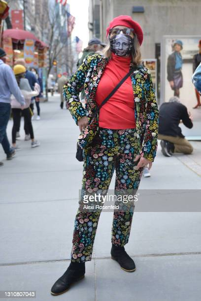 Woman wearing a floral suit and Dr. Anthony Fauci mask poses during the Easter Bonnet parade on Easter Sunday on April 4, 2021 in New York City. Due...