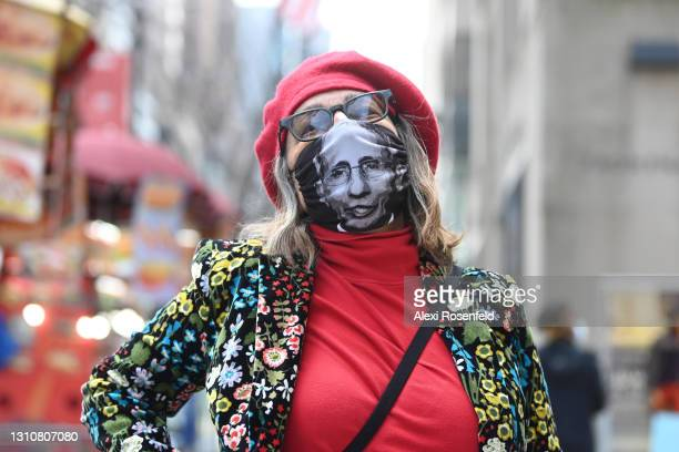 Woman wearing a flower suit and Dr. Anthony Fauci mask poses during the Easter Bonnet parade on Easter Sunday on April 4, 2021 in New York City. Due...