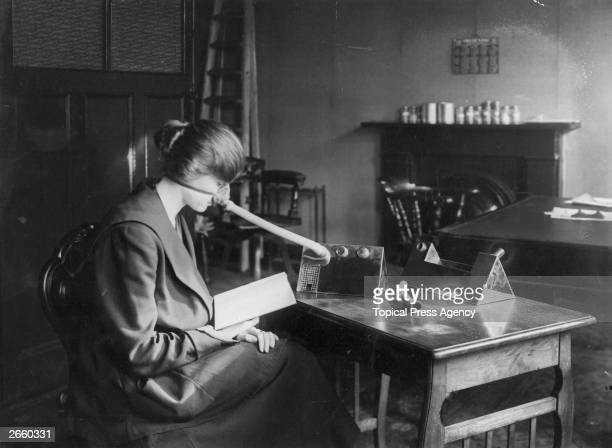 A woman wearing a flu mask during the flu epidemic which followed the First World War 27th February 1919