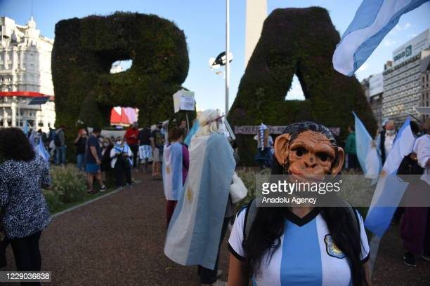 Woman wearing a gorilla mask attends a protest against the policies of the government of Argentinian President Alberto Fernandez and the quarantine...