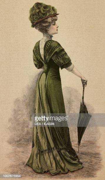 Woman wearing a green Crepe de Chine afternoon dress corset with pleated sleeves and a hat with flowers creation by Buzenet colored engraving from La...