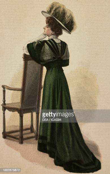 Woman wearing a green muslin Drap visiting dress with dark velvet inserts corset with lace inserts and trimmings hat with feathers creation by...