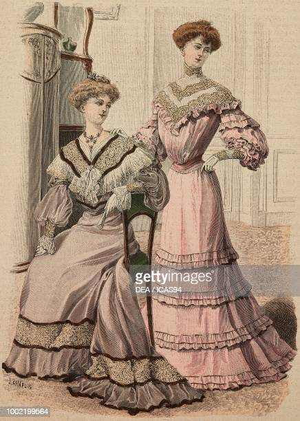 Woman wearing a grey velours meeting dress with lace woman wearing a pink crepe de Chine meeting dress creation by Mademoiselle Louise Piret...