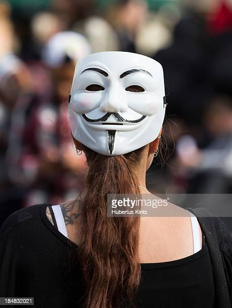CONTENT] Woman wearing a Guy Fawkes mask backwards during a antifascism protest on september 21 2013 in The Hague The Netherlands