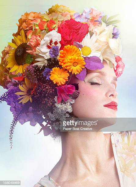 woman wearing a hat made of colorful flowers