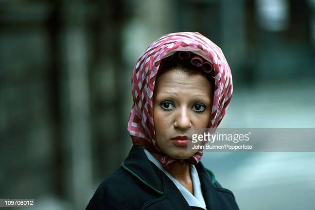 A woman wearing a headscarf over her curlers Manchester 1977