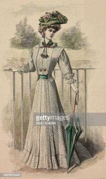 Woman wearing a holiday dress white and grey woolen fabric and a hat with ribbons and flowers creation by Martial and Armand colored engraving from...