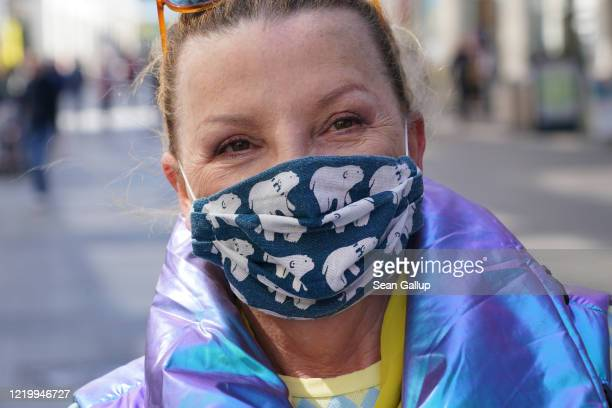 Woman wearing a home-made protective face mask allows herself to be photographed during the novel coronavirus crisis on April 20, 2020 in Leipzig,...