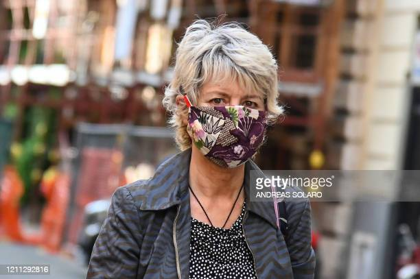 Woman wearing a homemade protective face mask looks on in Rome on April 29, 2020 during the country's lockdown aimed at stopping the spread of the...