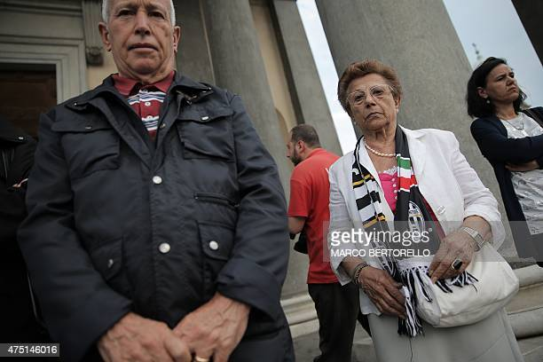 Woman wearing a Juventus scarf stands outside the Gran Madre di Dio church in Turin on May 29 before attending a mass to mark the 30th anniversary of...
