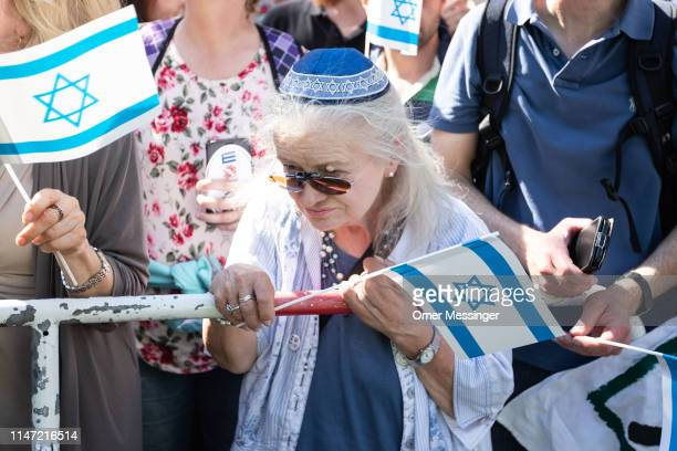 A woman wearing a Kippa with a Star of Daviv pattern on it is seen among other counter demonstrators as the annual AlQuds march pass by on June 1...