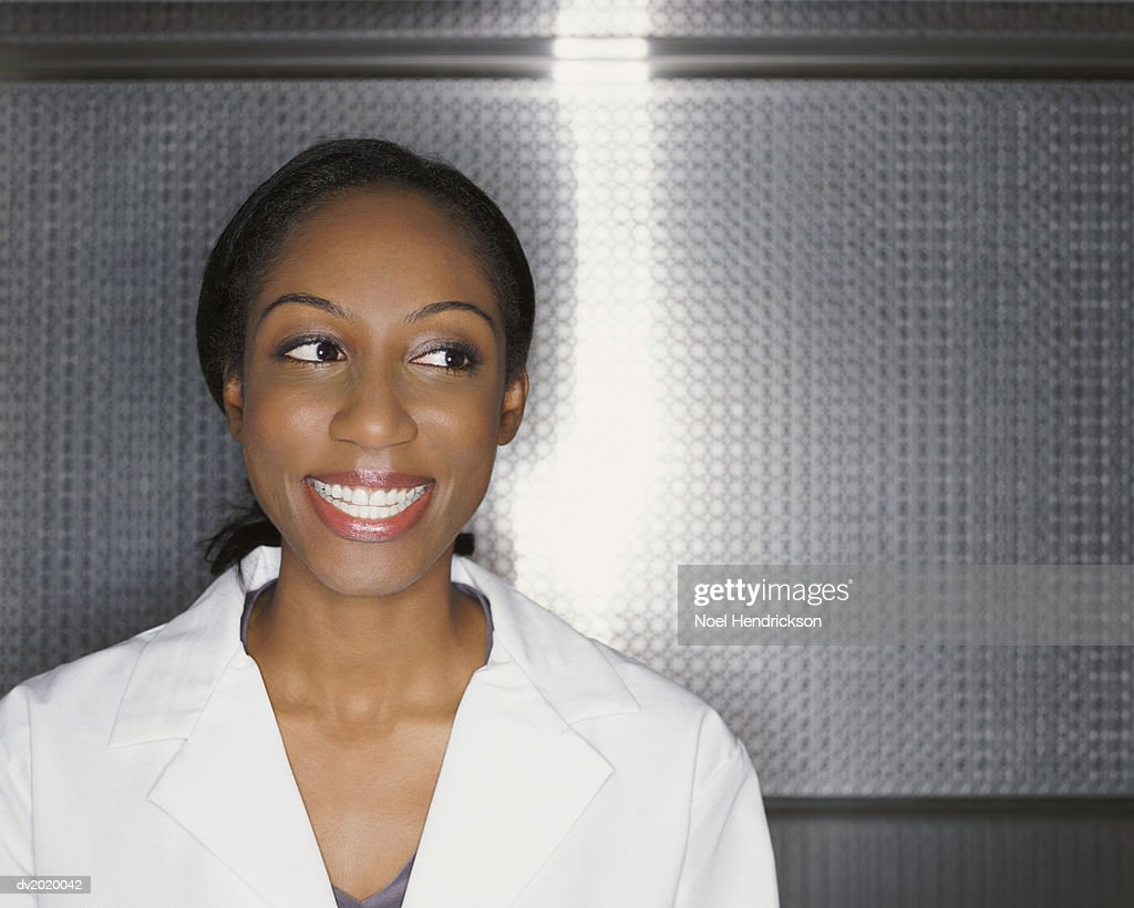 Woman Wearing a Lab Coat and Smiling : Stock Photo