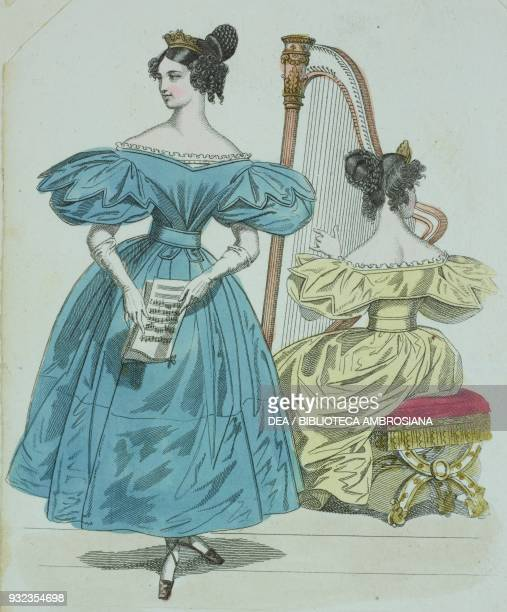 Woman wearing a light blue dress with shortpuffed sleeves gloves and a tiara and a woman wearing the same dress in yellow seated in the background...